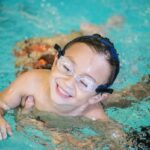 student smiling in the water