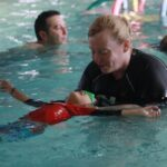 swim instructor working with a student